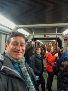 Meeting our brother-in-law (cuñado) and his wife (concuña) on the Metro - can you tell which guy came all the way from Yucatan ?