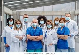 Group Doctors Face Masks Looking Camera : Foto de stock (editar ahora)  1641184876